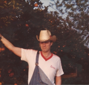 Me picking oranges in Mission, Texas
