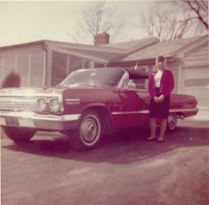 Joyce standing beside new '63 Chevy Impala Convertible